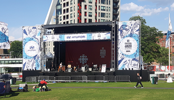 As for the stage graphics, the shop imaged 3600 square feet of fabric banners using Techno Mesh, Torino media, and Bellagio fabric that was dye sublimated on the Durst Rhotex 320.