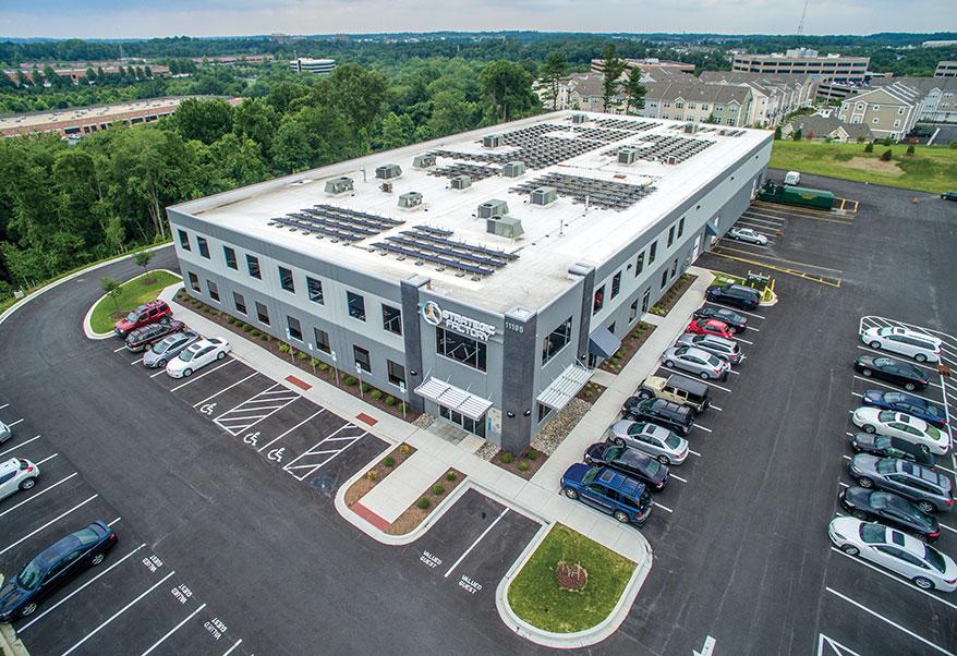 A 100-kilowatt solar array sits on top of Strategic Factory's building.